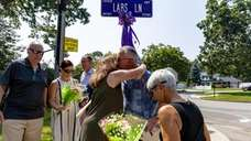 Families and friendsgathered Saturday in Smithtownto rememberthe four