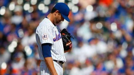 Mets starter Jacob deGrom pauses before pitching against