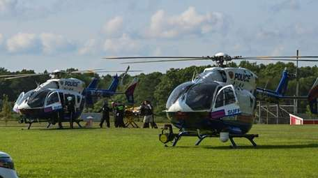 A patient is rushed to a helicopter on