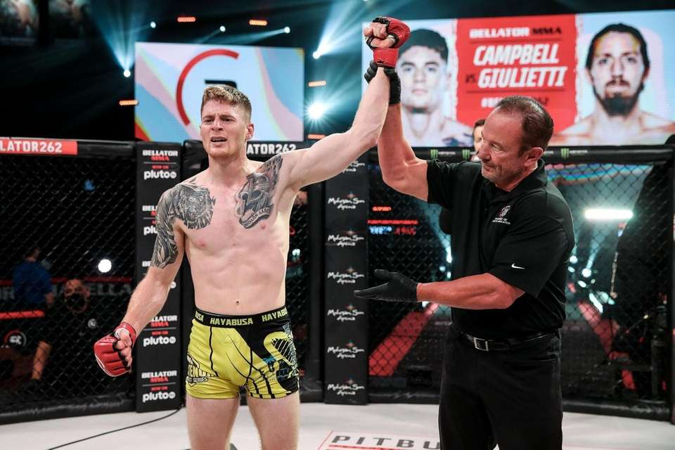 Charlie Campbell celebrates his second-round TKO of Nicholas