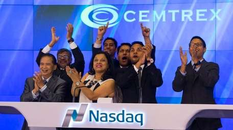 Saagar Govil, right, CEO of Cemtrex, celebrates with
