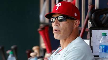 Phillies manager Joe Girardi looks on during the