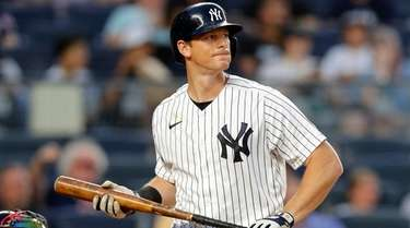 DJ LeMahieu of the Yankees strikes out to