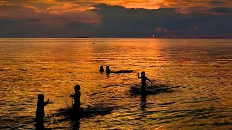 Children frolic in the waters of the Chesapeake
