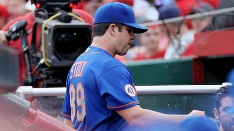 Robert Stock of the Mets leaves the game