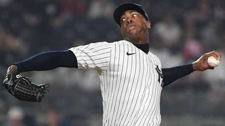 Yankees relief pitcher Aroldis Chapman delivers against the