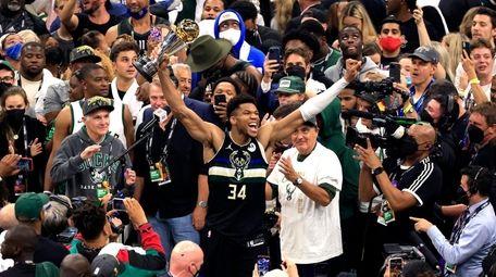 Giannis Antetokounmpo of the Milwaukee Bucks celebrates winning