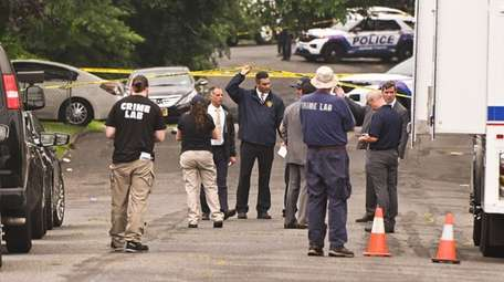 Suffolk police investigate a fatal shooting behind stores