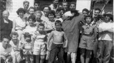 Infant Joe Gentile in 1952, held by his