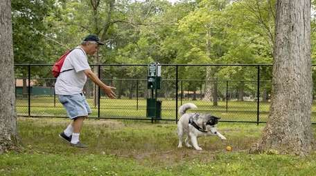 North Babylon resident Adam Lee with his dog