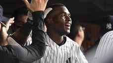 The Yankees' Estevan Florial is greeted in the