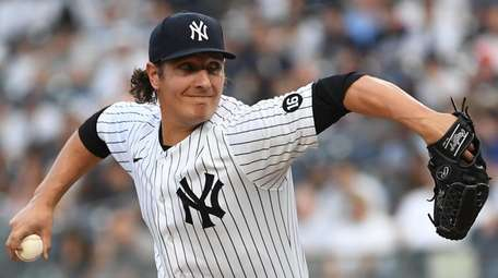 Yankees starting pitcher Asher Wojciechowski delivers against the