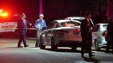 Nassau County police investigate a fatal crash in