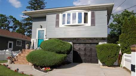 Listed for $674,000, this 3-bedroom, 2-bath home on