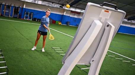Erin Schaefer practices her lacrosse game on the