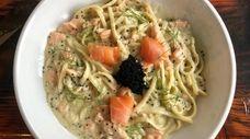 A bowl of steelhead trout carbonara pasta at
