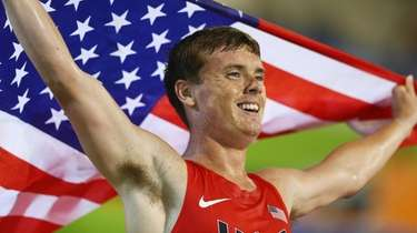 Mikey Brannigan celebrates winning gold in the men's
