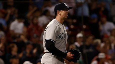 Yankees pitcher Brooks Kriske walks back to the