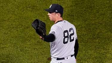 Yankees relief pitcher Brooks Kriske looks for the