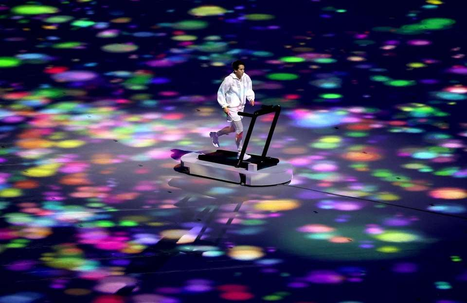 A performer runs on a treadmill during the