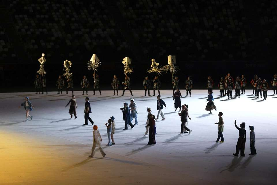 A group of performers carry out a routine