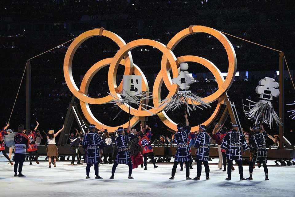 Perfomers are seen dancing infront of the Olympic