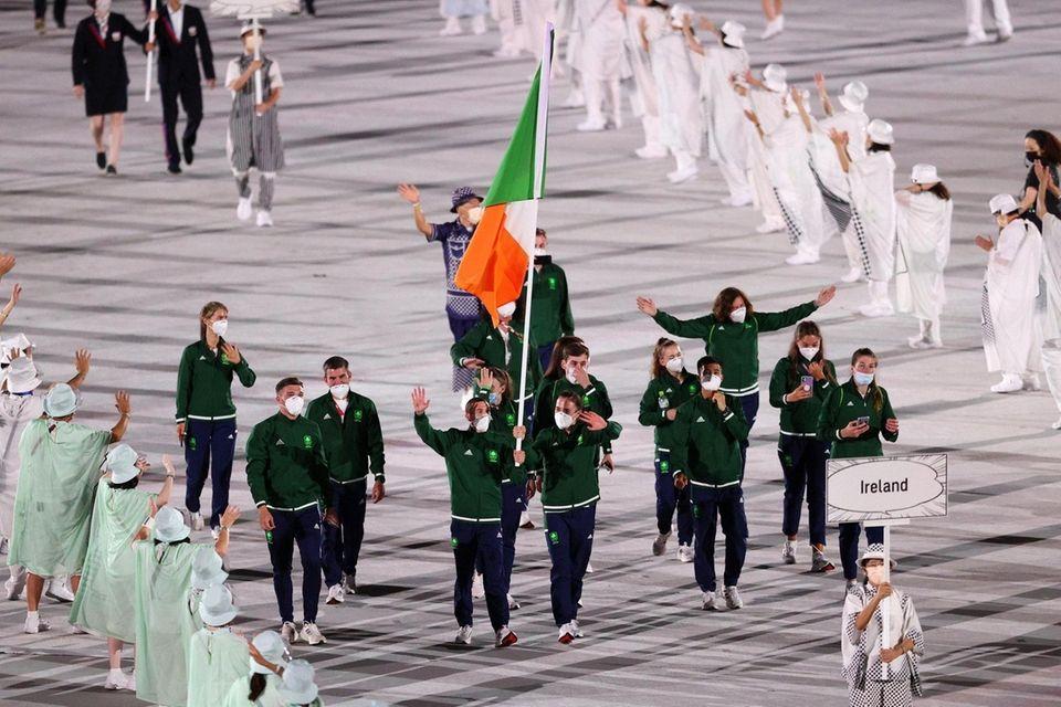 Flag bearers Kellie Anne Harrington and Brendan Irvine