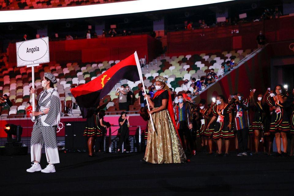 Flag bearer Natalia Santos of Team Angola leads
