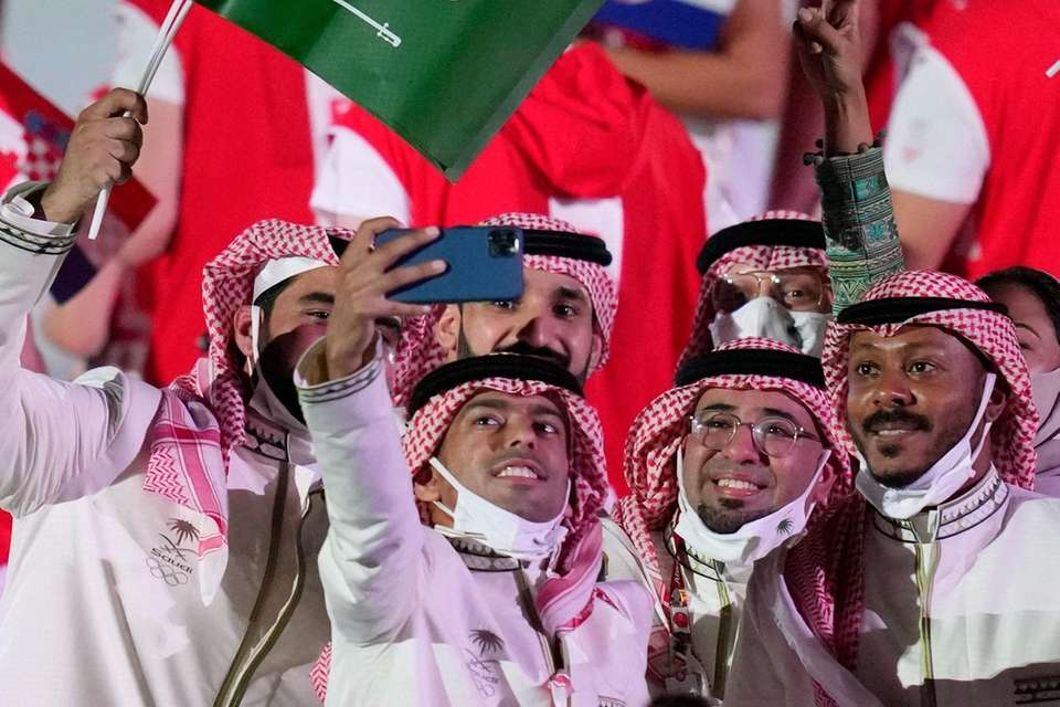 Athletes from Saudi Arabia walk during the opening