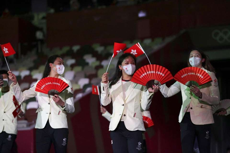Team Hong Kong arrives during the opening ceremony