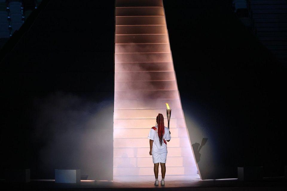 Naomi Osaka of Team Japan carries the Olympic