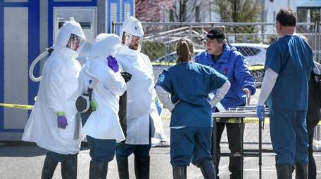 Technicians in protective clothing at Stony Brook University's