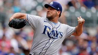 Tampa Bay Rays starting pitcher Rich Hill delivers
