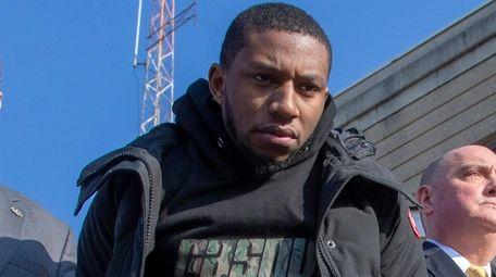 Jamik Q. Cannon leaves Nassau Police Headquarters in