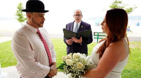 Stephen and Serena Normandia, of Elmont, exchanged vows