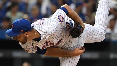 Mets starting pitcher Tylor Megill delivers against the