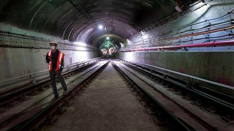 A worker walks the East Side Access railroad