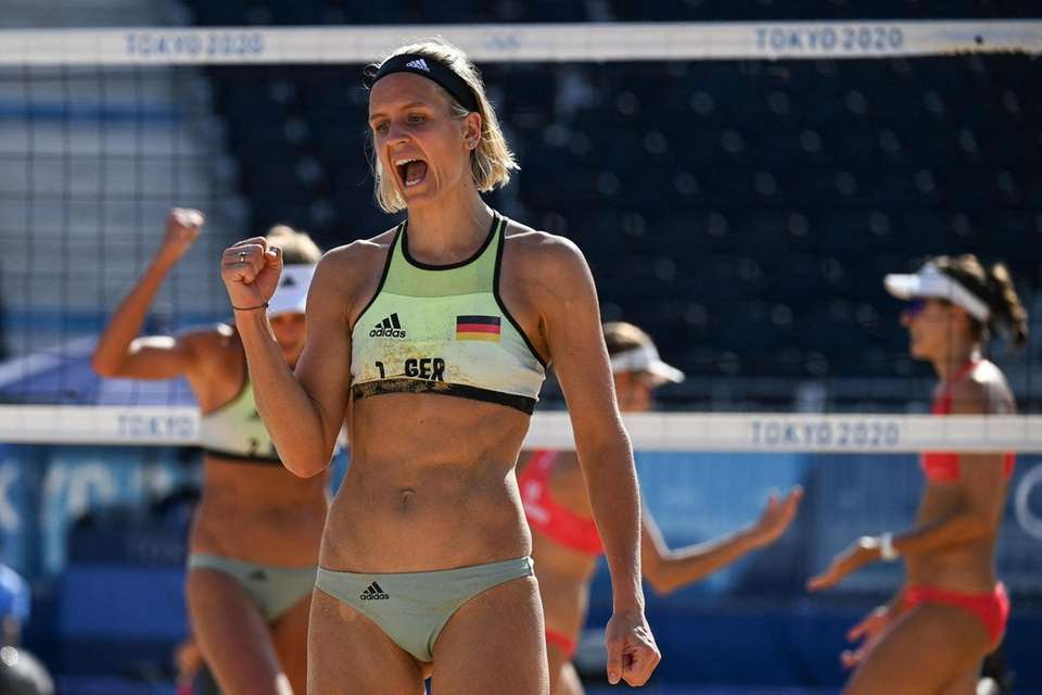 Germany's Laura Ludwig reacts in their women's preliminary