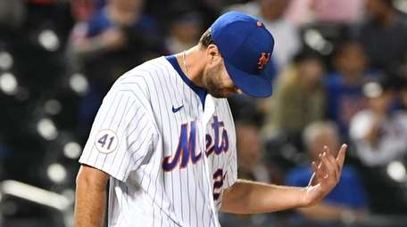 Mets starting pitcher David Peterson reacts after Phillies