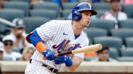 Jeff McNeil of the Mets follows through on