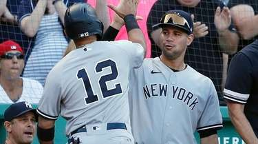 The Yankees' Rougned Odor celebrates after scoring on
