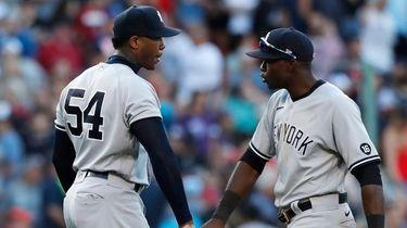 Yankees' Aroldis Chapman and Estevan Florial celebrate after
