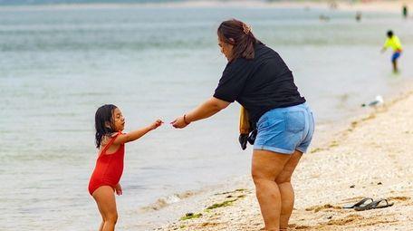 Adilene hands her mother Yazmin Ramos of Queens