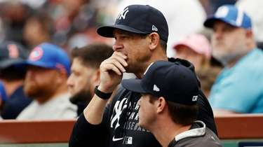 Manager Aaron Boone #17 of the Yankees looks