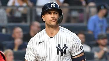 Yankees designated hitter Giancarlo Stanton reacts after he