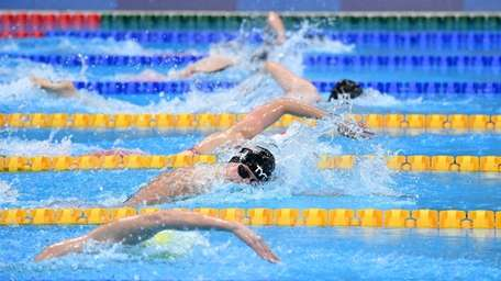 Katie Ledecky (C) competes to take silver in