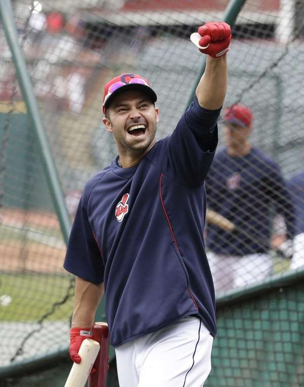 Nick Swisher pumps his fist during batting practice
