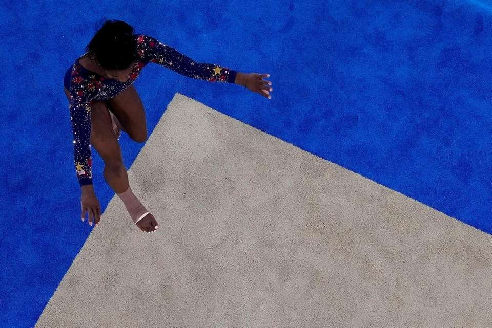 Simone Biles, of United States, steps out as