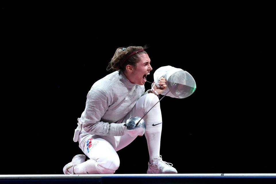 Sofia Pozdniakova of Team ROC celebrates after winning
