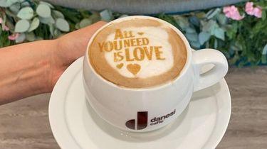 A caramel cappuccino with a custom art design